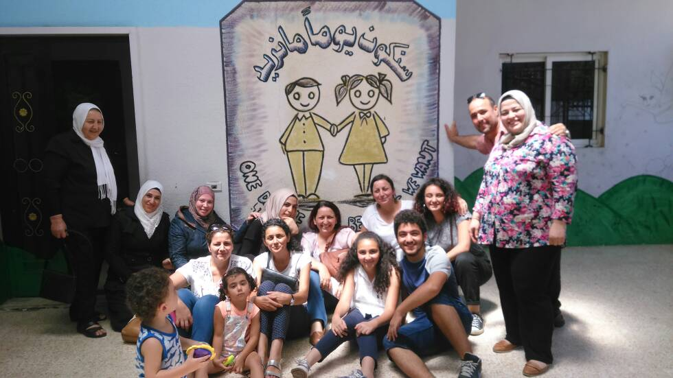 fifteen teachers in a group portrait who are all working for the refugee school Gharsah in Lebanon